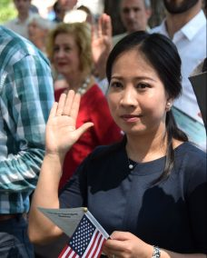 Taking the oath at the naturalization ceremony
